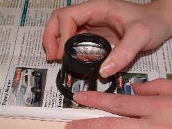 Stand magnifier for low vision reading